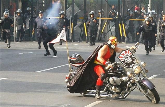 Luchador wrestler on a motorbike