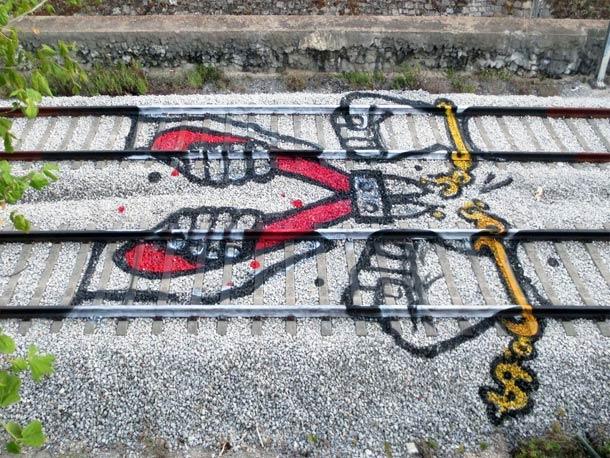 Portuguese artist Artur Bordalo rail track art